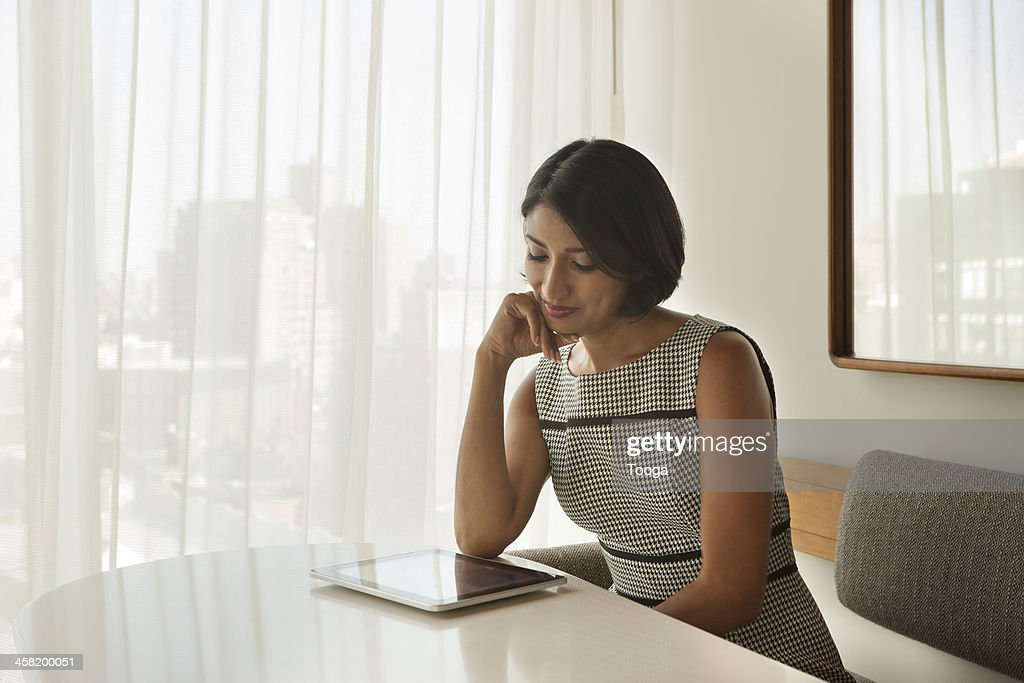 Professional Woman reading digital tablet