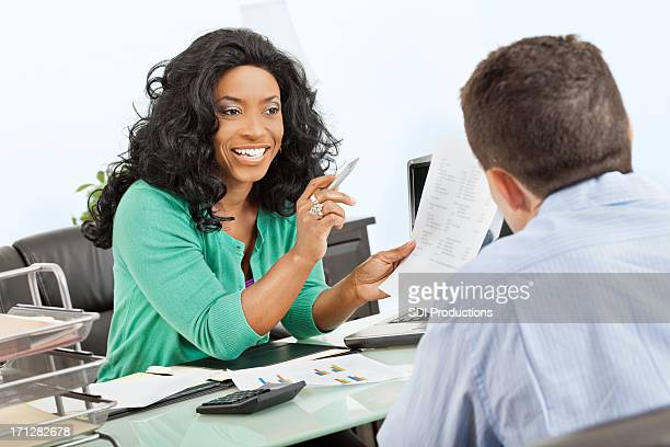 Professional woman speaking with colleague or client