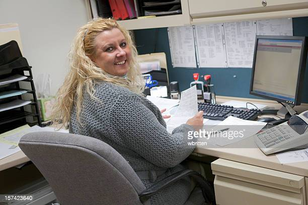A professional woman working at her desk