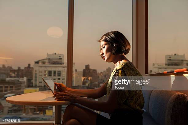Professional woman working late in city