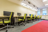 Computer room with green swivel chairs and fitted carpet