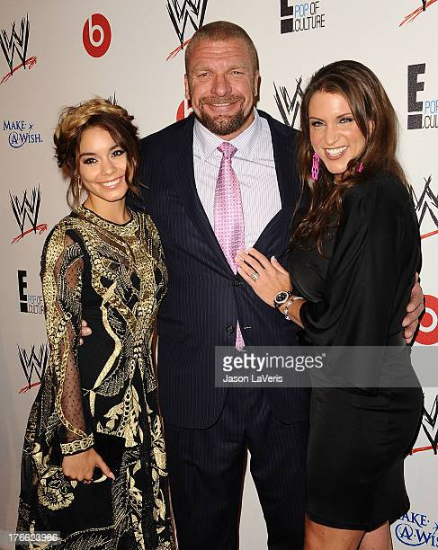 Professional wreslter Paul Levesque aka Triple H actress Vanessa Hudgens and WWE Executive Vice President of Creative Stephanie McMahon attend the...