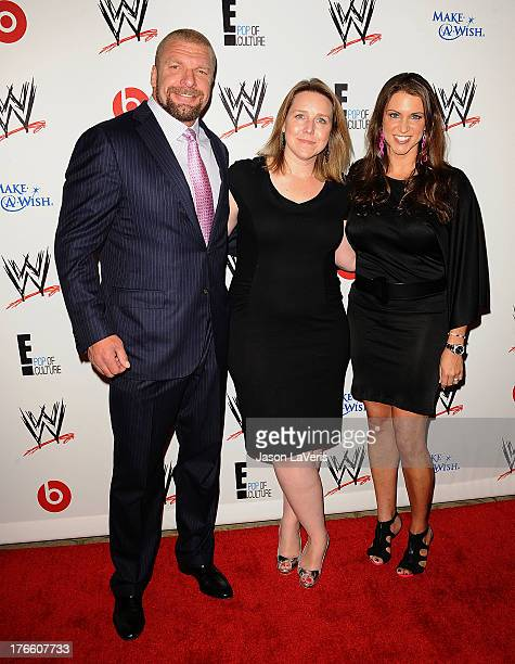 Professional wreslter Paul Levesque aka Triple H President of E Entertainment Suzanne Kolb and WWE Executive Vice President of Creative Stephanie...