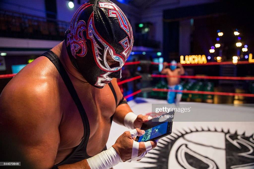 Professional wrestler and actor Silver King checks his phone during a photo call at York Hall in Bethnal Green on July 1, 2016 in London, England. A number of luchadores will perform in 'The Greatest Spectacle of Lucha Libre', which takes place over two days and features Mexican and British stars from the world of Mexican Wrestling.