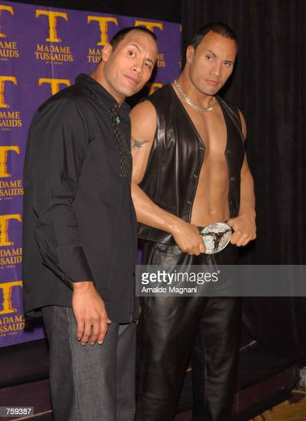 Professional wrestler Dwayne 'The Rock' Johnson poses at the unveiling of his wax portrait at Madame Tussaud's Wax Museum April 10 2002 in New York...