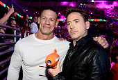 Professional wrestler John Cena and actor Robert Downey Jr winner of Favorite Male Butt Kicker backstage during Nickelodeon's 27th Annual Kids'...