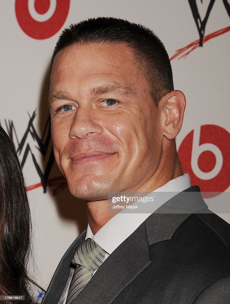 Professional wrestler <a gi-track='captionPersonalityLinkClicked' href=/galleries/search?phrase=John+Cena&family=editorial&specificpeople=644116 ng-click='$event.stopPropagation()'>John Cena</a> attends WWE & E! Entertainment's 'SuperStars For Hope' at the Beverly Hills Hotel on August 15, 2013 in Beverly Hills, California.