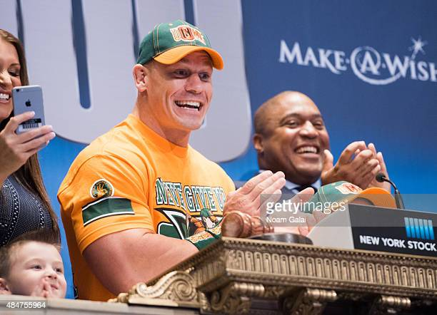 Professional wrestler John Cena rings the NYSE opening bell at New York Stock Exchange on August 21 2015 in New York City