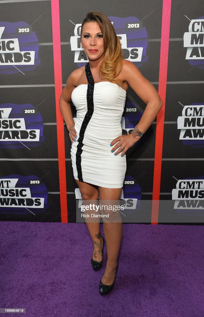 Professional wrestler Mickie James attends the 2013 CMT Music awards at the Bridgestone Arena on June 5, 2013 in Nashville, Tennessee.