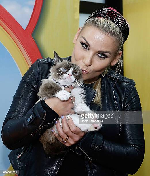 Professional wrestler Natalya Neidhart presents Grumpy Cat during Friskies Create Taste Kitchen Press Preview on August 19 2015 in New York City