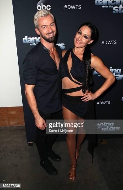 Professional wrestler Nikki Bella and dancer Artem Chigvintsev attend 'Dancing with the Stars' season 25 at CBS Televison City on October 9 2017 in...