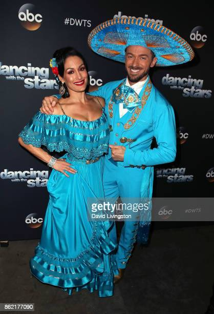 Professional wrestler Nikki Bella and dancer Artem Chigvintsev pose at 'Dancing with the Stars' season 25 at CBS Televison City on October 16 2017 in...