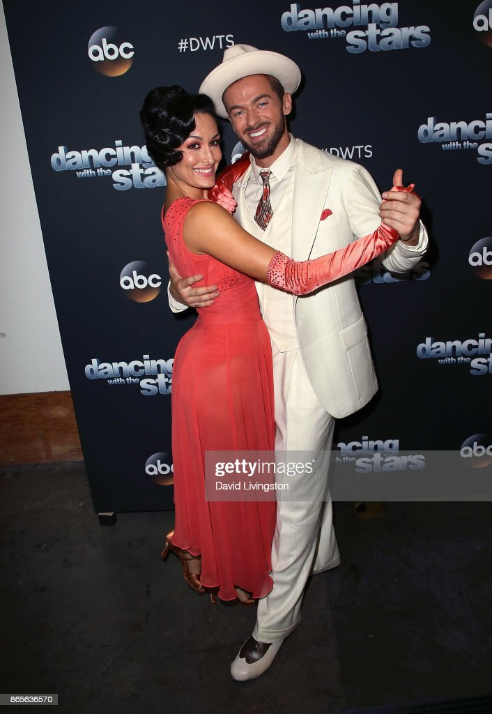 Professional wrestler Nikki Bella (L) and dancer Artem Chigvintsev pose at 'Dancing with the Stars' season 25 at CBS Televison City on October 23, 2017 in Los Angeles, California.