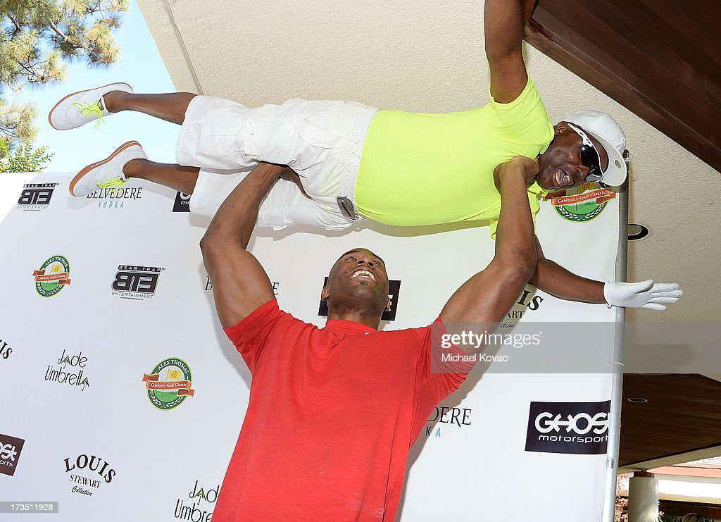 Professional wrestler Shad Gaspard lifts comedian Alex Thomas at The 4th annual Alex Thomas Celebrity Golf Classic presented by Belvedere at Mountain Gate Country Club on July 15, 2013 in Los Angeles, California.