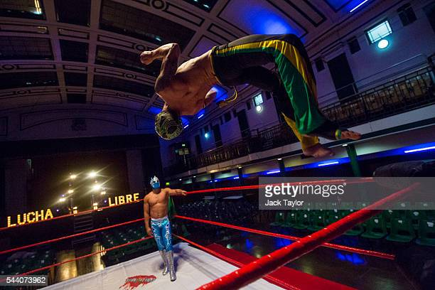 Professional wrestler Zumbi leaps from the ropes of a wrestling ring during a photo call at York Hall in Bethnal Green on July 1 2016 in London...