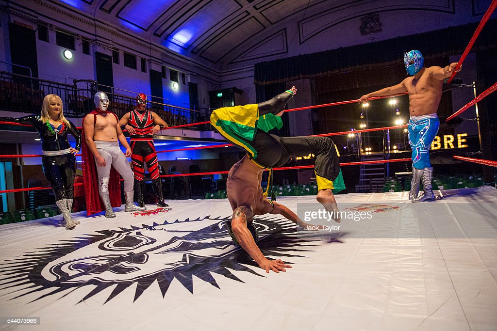 Professional wrestler Zumbi (C) performs during a photo call at York Hall in Bethnal Green on July 1, 2016 in London, England. A number of luchadores will perform in 'The Greatest Spectacle of Lucha Libre', which takes place over two days and features Mexican and British stars from the world of Mexican Wrestling.