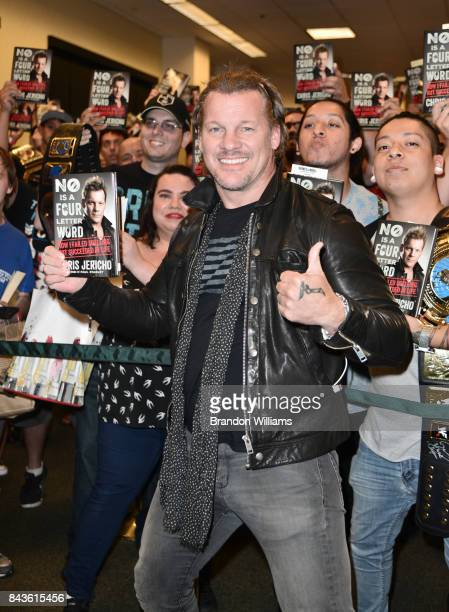Professional wrestler/Musician Chris Jericho poses with fans at his book signing for 'No Is A FourLetter Word' at Barnes Noble at The Grove on...