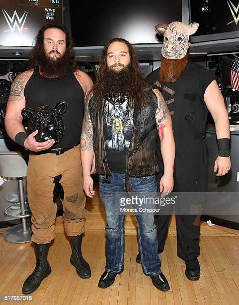 WWE professional wrestlers Braun Strowman Bray Wyatt and Erick Rowan attend WWE WrestleMania Stars Ring The NYSE Opening Bell at New York Stock...