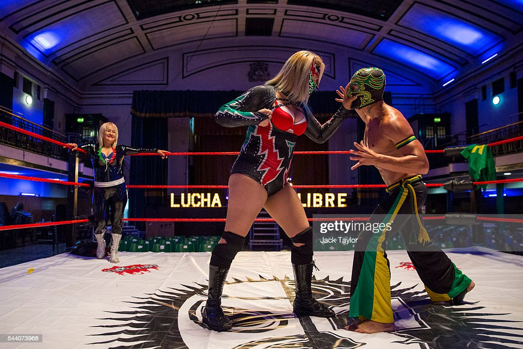 Professional wrestlers Chika Tormenta (C) and Zumbi (R) perform during a photo call at York Hall in Bethnal Green on July 1, 2016 in London, England. A number of luchadores will perform in 'The Greatest Spectacle of Lucha Libre', which takes place over two days and features Mexican and British stars from the world of Mexican Wrestling.