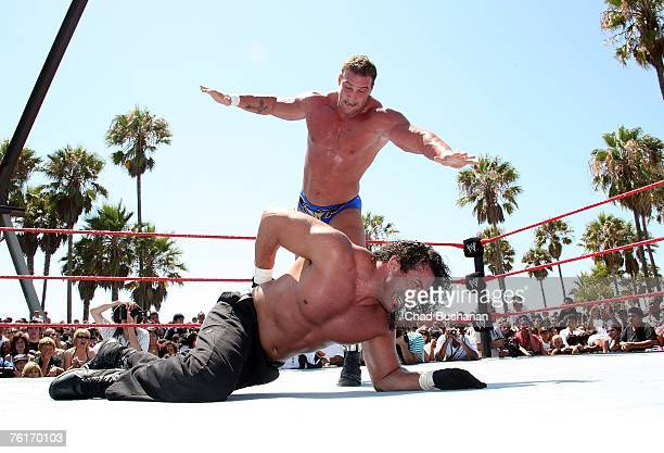 Professional Wrestlers Chuck Palumbo and Chris Masters battle in WWE Takes Over Venice Beach August 18 2007 in Los Angeles California