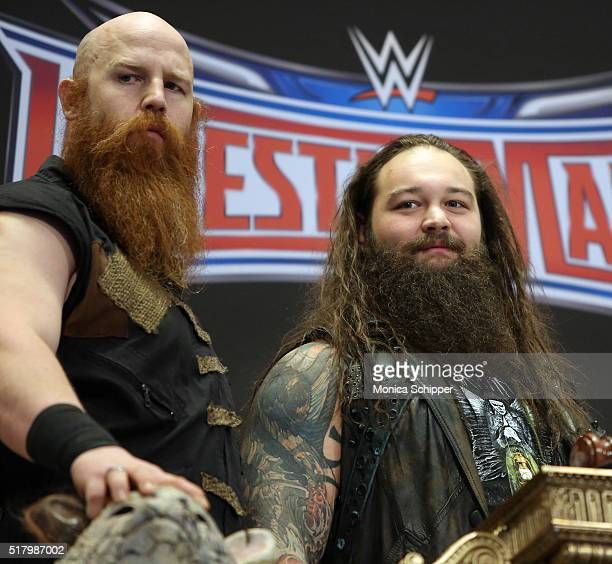 WWE professional wrestlers Erick Rowan and Bray Wyatt attend WWE WrestleMania Stars Ring The NYSE Opening Bell at New York Stock Exchange on March 29...