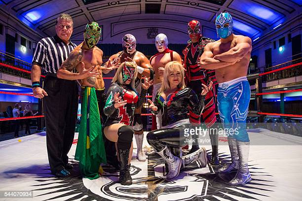 Professional wrestlers Mano Negra Zumbi Chika Tormenta Silver King Santo Jr Lady Apache Magno and Magnifico pose during a photo call at York Hall in...