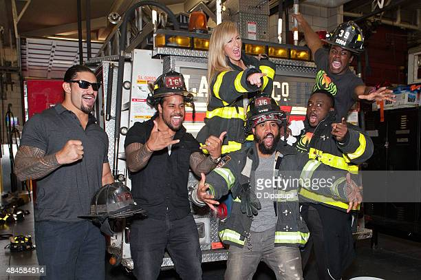Professional wrestlers Roman Reigns Jey Uso Summer Rae Jimmy Uso Big E Langston and Xavier Woods attend WWE Answer The Call Tour Visits Engine...