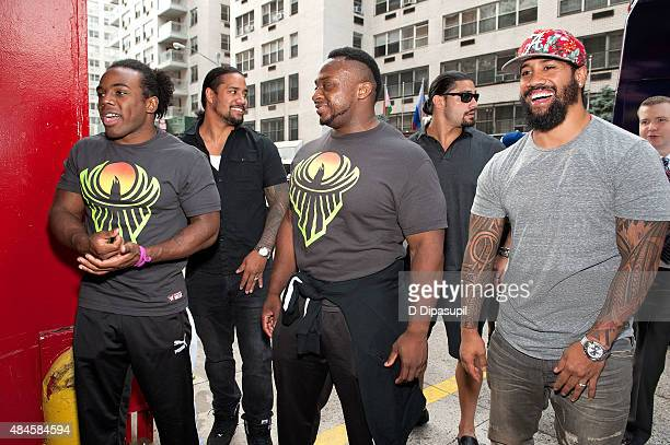 Professional wrestlers Xavier Woods Jey Uso Big E Langston Roman Reigns and Jimmy Uso attend WWE Answer The Call Tour Visits Engine 39/Ladder 16 on...