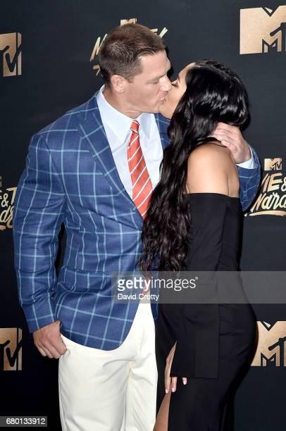Professional wrestlersactors John Cena and Nikki Bella pose in the press room during the 2017 MTV Movie And TV Awards at The Shrine Auditorium on May...