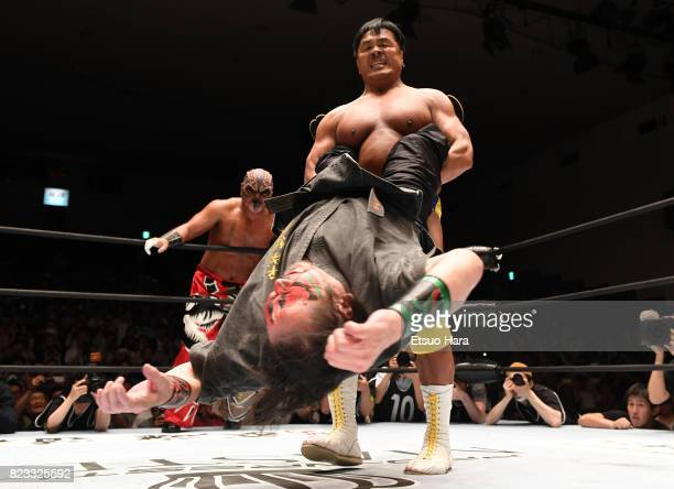 Professional wrestlerturnedlawmaker and former Education Minister Hiroshi Hase and The Great Kabuki compete during the Prowrestling Masters at...