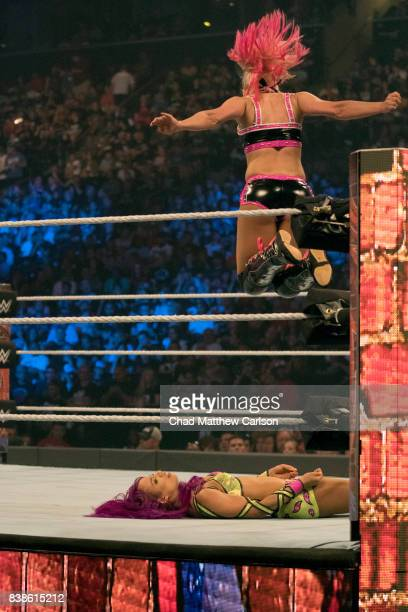 WWE SummerSlam Alexa Bliss in action leaping down on and vs Sasha Banks at Barclays Center Brooklyn NY CREDIT Chad Matthew Carlson