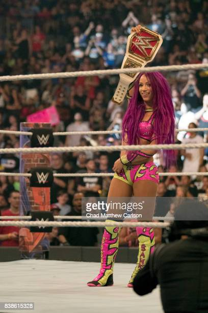 WWE SummerSlam Sasha Banks victorious holding belt after match vs Alexa Bliss at Barclays Center Brooklyn NY CREDIT Chad Matthew Carlson