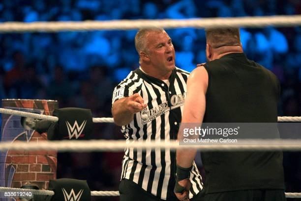 WWE SummerSlam Special guest referee Shane McMahon arguing with Kevin Ownes during match vs AJ Styles at Barclays Center Brooklyn NY CREDIT Chad...