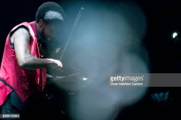 WWE SummerSlam Violinist Lee England Jr performing before Shinsuke Nakamura's entrance before match vs Jinder Mahal at Barclays Center Brooklyn NY...