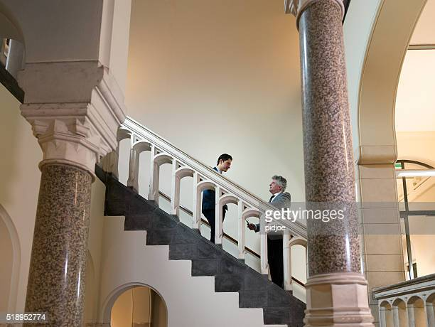 Professionals in Discussion on Staircase