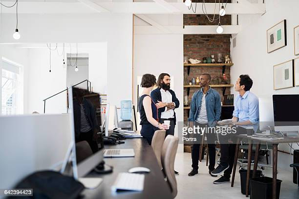 Professionals talking during coffee break