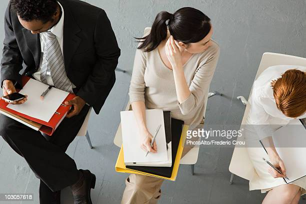 Professionals waiting for meeting to begin