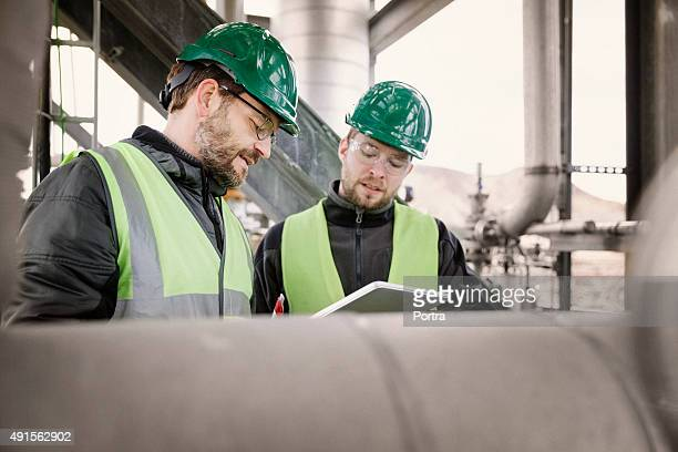 Professionals working at factory