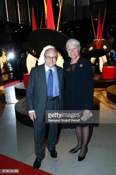Professor Alain Pompidou and his wife Nicole pose in front the works of JeanPaul Goude during the 'Societe des Amis du Musee d'Art Moderne du Centre...