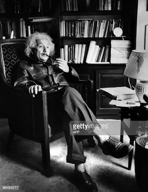 Professor Albert Einstein smokes a pipe on June 02 in his home at Princeton University Einstein was a Germanborn theoretical physicist He is best...