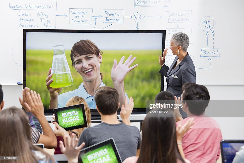 Professor and scientist teaching via video conference