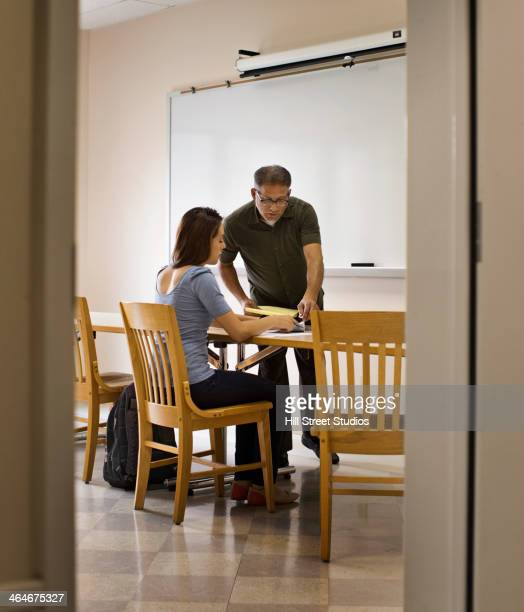 Professor and student working in classroom