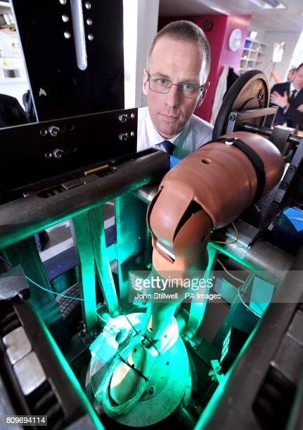 Professor Anthony Bull from the Department of Bioengineering at Imperial College London stands by a false leg used in a bomb blast simulation rig at...