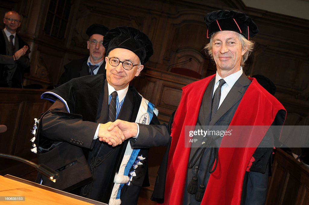 Professor Antonio Damasio of Portugal (L) shakes hands with KUL's Rector Mark Waer during a press conference ahead of the honorary degrees ceremony on the occasion of the KU Leuven university's Patron Saint's Day, on February 4, 2013. Damasio is a university professor and David Dornsife Professor of Neuroscience and Director of the Brain and Creativity Institute at the University of Southern California. AFP PHOTO /BELGA/ YORICK JANSENS Belgium Out
