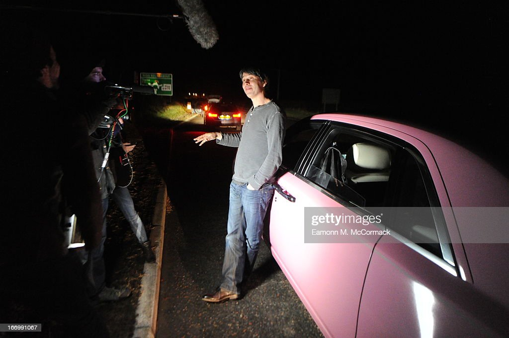 Professor Brian Cox takes road-side interview during the FAB1 Million drive from Land's End to John O'Groats on April 18, 2013 in Inverness, United Kingdom. FAB1 Million aims to raise one million pounds for Breast Cancer Care using a bespoke pink Rolls Royce Ghost with the original FAB1 Thunderbirds number plate, which is available for hire.