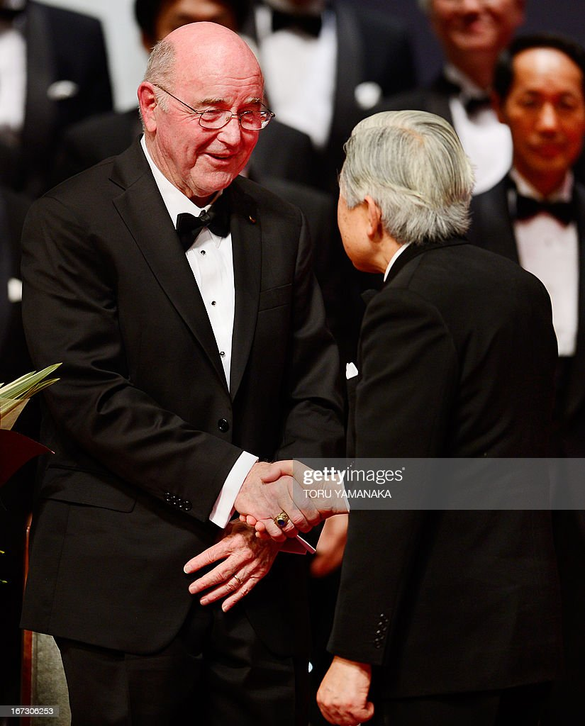 Professor C. Grant Wilson (L) of the US is congratulated by Japanese Emperor Akihito (R) during the awards ceremony for the Japan Prize in Tokyo on April 24, 2013. Willson and his compatriot, Professor Jean M. J. Frechet, were jointly awarded the prize in the materials and production field to develop chemically amplified resistant polymer materials for the innovative semiconductor manufacturing process. The Japan Prize is awarded annually to scientists and engineers from around the world who have made significant contributions to the advancement of science and technology, furthering the cause of peace and prosperity. AFP PHOTO/Toru YAMANAKA