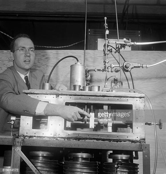 Professor Charles H Townes executive of the physics department at Columbia University is shown with the 'atomic clock' in the university's physics...