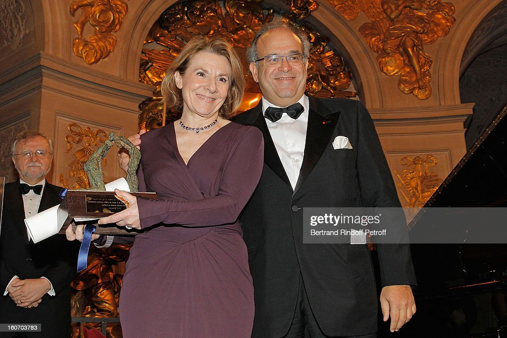 Professor David Khayat (R) and Catherine Pegard, President of Chateau de Versailles, pose after Pegard received the Grand Prize of the Paris Charter against Cancer during the gala dinner of Khayat's association 'AVEC', at Chateau de Versailles on February 4, 2013 in Versailles, France.