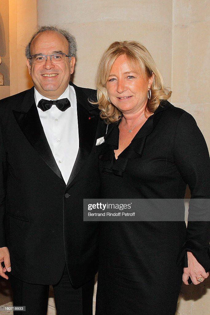 Professor David Khayat (L) and Florence Pinault attend the gala dinner of Khayat's association 'AVEC', at Chateau de Versailles on February 4, 2013 in Versailles, France.