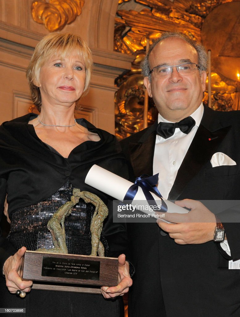 Professor David Khayat (R) and Marie-Christiane Marek pose after Marek received the Prize of the Paris Charter against Cancer during the gala dinner of Khayat's association 'AVEC', at Chateau de Versailles on February 4, 2013 in Versailles, France.